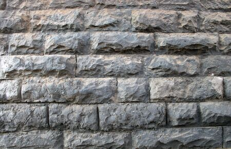decorative wall of stones and bricks 스톡 콘텐츠