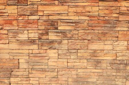 Decorative yellow brick wall for background.