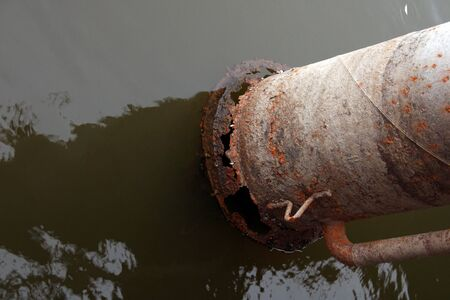 rusted water pump pipe in water