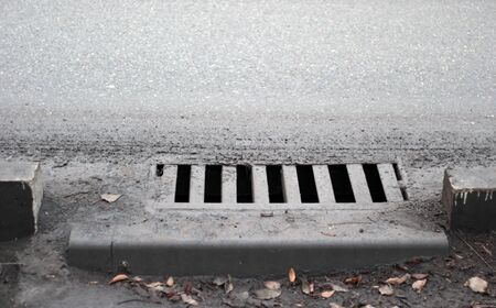 Sewer by footpath. Stormwater street drain