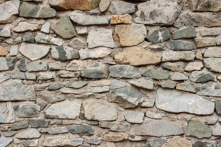 wild decorate stone wall texture. natural facade home dry background. old grunge rocks retro vintage wallpaper