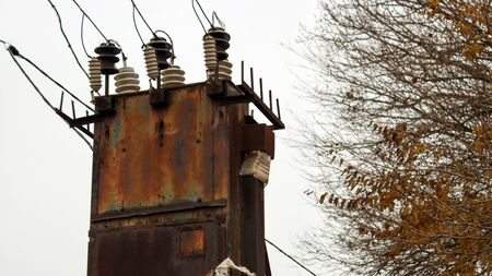 Old abandoned rusty transformer station