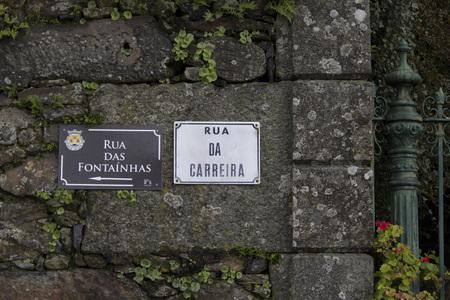 slab: wall gate stone wall stone plaque slab plate street ivy Stock Photo