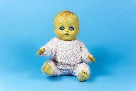 infantile: vintage doll, dolly, puppet, old toy, retro, blue background, infant, infantile, childish