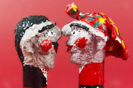 craftwork: handicraft, craftwork, workmanship, couple, pair, twosome, couplet, bighead, red background Stock Photo