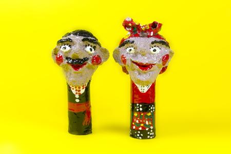 workmanship: handicraft, craftwork, workmanship, couple, pair, twosome, couplet, bighead, yellow background