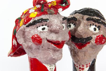 twosome: handicraft, craftwork, workmanship, couple, pair, twosome, couplet, bighead, white background Stock Photo