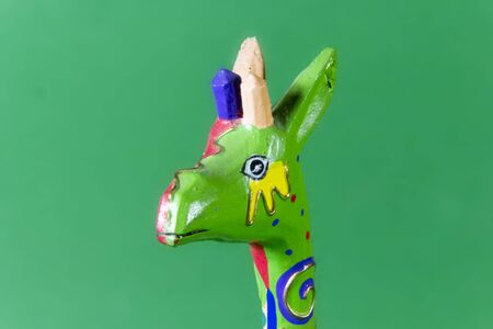 workmanship: handicraft, craftwork, workmanship, giraffe, camelopard, colorful, colourful, colored, green background
