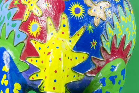 workmanship: handicraft, craftwork, workmanship, giraffe, camelopard, colorful, colourful, colored, green background