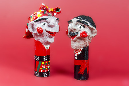 twosome: handicraft, craftwork, workmanship, couple, pair, twosome, couplet, bighead, red background Stock Photo