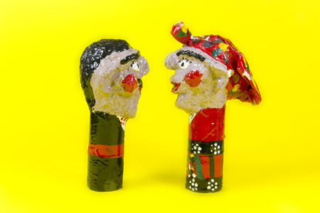 twosome: handicraft, craftwork, workmanship, couple, pair, twosome, couplet, bighead, yellow background