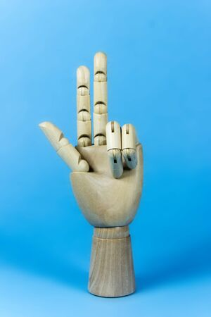 three fingers: hand, wood, wooden, hand, three, fingers, blue, background