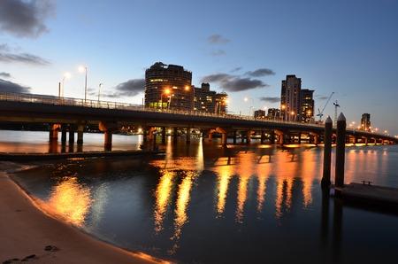 gold coast: Sundale Bridge with Southport skyline at sunset in Gold Coast, Queensland AUstralia. Stock Photo