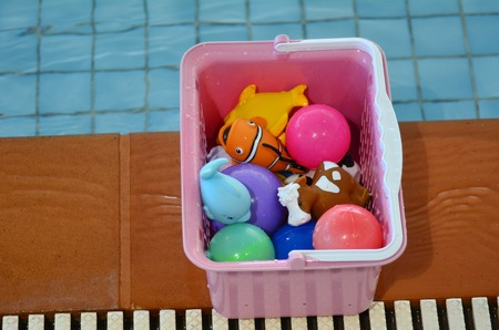 toy box: Water toy box beside swimming pool. Background texture. concept photo water, sport, swimming.