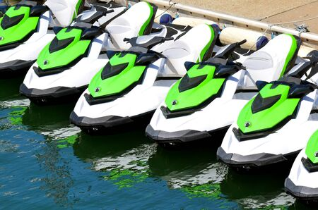 personal watercraft: Line of personal watercraft. Concept photo extreme water sport and transportation