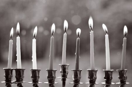 judaical: Hanukkah menorah lit with eight candles at the last day of Hanukah. (BW)