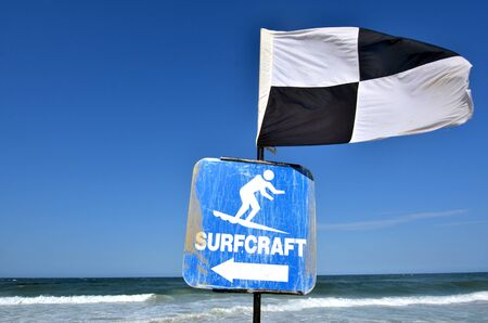 quartered: Australian Lifeguards  Beach Safety Flags Australian Lifeguards Black and White Quartered Flag.Indicates the area where board riding and surfing is not permitted.