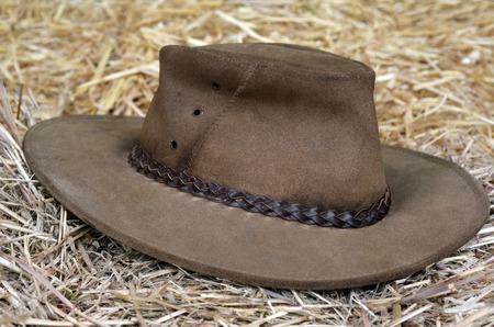 stockman: Australian hat on hay in a barn. Stock Photo