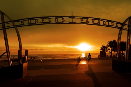 Surfer on the way to surf during sunrise in Surfers Paradise Gold Coast Queensland ,Australia. 写真素材
