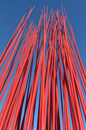 round rods: Red metal poles against blue sky. Abstract texture background.