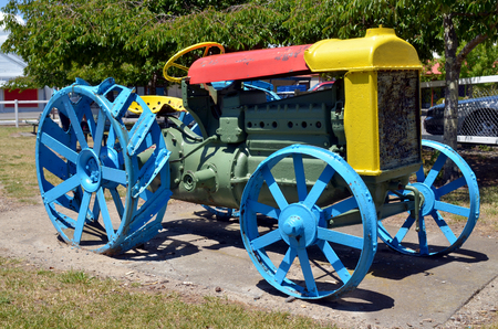 outside machines: Old tractor painted with may colors park in outdoor  playground.