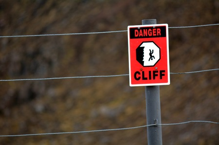 taking a risk: Danger Cliff sign and symbol. concept photo of danger and risk taking. copyspace Stock Photo