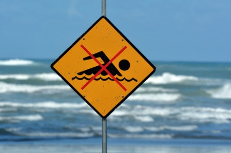 no swimming: New Zealand sea warning sign at the beach with man swim and not symbol, Caution No Swimming allowed. concept conceptual. Stock Photo