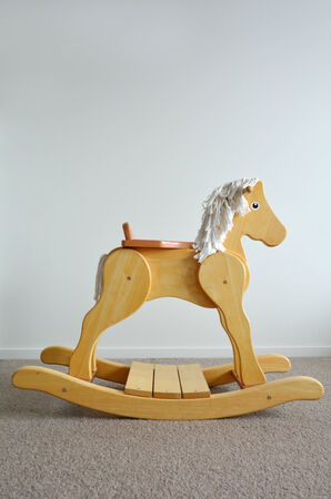 Wooden Rocking Horse. Childhood concept. copyspace photo