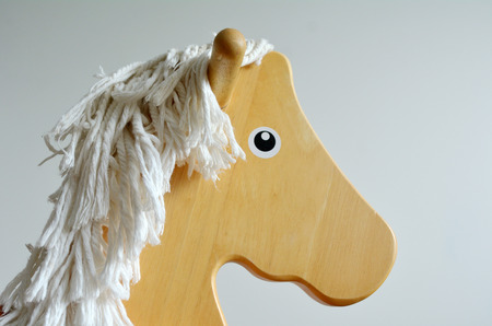 Wooden Rocking Horse face. Childhood concept. copyspace photo
