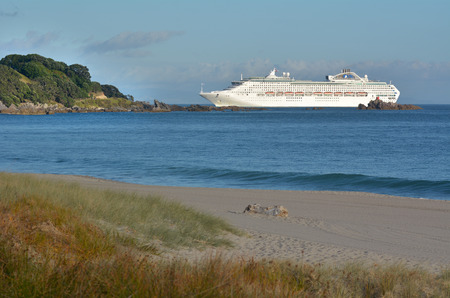 enters: MOUNT MAUNGANUI, NZL - JAN 18 2015:Cruise ship enters Port of Tauronga. Its a very popular travel destination in the Bay of Plenty, New Zealand. Editorial
