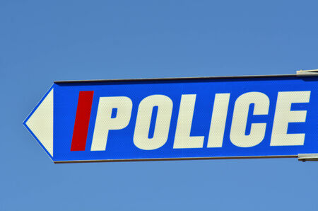 precinct station: Police road sign with text against blue sky. concept photo of security