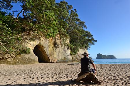 north island: Mature man visit in Te WhanganuiAHei Cathedral Cove Marine Reserve in Coromandel Peninsula North Island New Zealand.