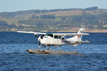 amphibious: ROTORUA, NZL - JAN 12 2015:Floatplane mooring on Lake Rotorua, New Zealand.Seaplanes can only take off and land on water with little or no waves and have trouble in extreme weather. Editorial