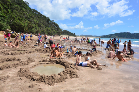 hot water geothermal: WHITIANGA, NZL - Jan 20 2015:Visitors making small hot water pools in Hot Water beach.it one of the most popular geothermal attractions in New Zealand, about 700,000 people visit the beach annually. Editorial