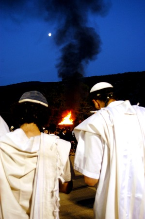 rabbi: MT MERON - MAY 16: Ultra Orthodox Jewish Men celebrate Lag Bomer Jewish holiday at the tomb of Rabbi Simeon bar Yohai on May 16 2006 in mount Meron,Israel. Its honor his memory by lighting candles or bonfires, symbolic of the light provided by the eterna