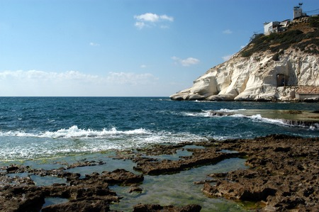 hanikra: Rosh HaNikra  head of the grottos a geologic formation of a white chalk cliff face which opens up into spectacular grottos located on the coast of the Mediterranean Sea in the Western Galilee in North Israel. Stock Photo
