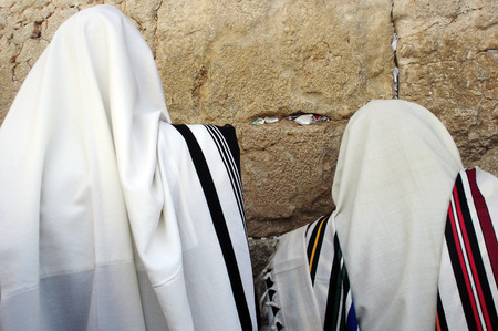 western wall: Jewish Men are praying wrapped in talit at the western wall in the old city in Jerusalem, Israel