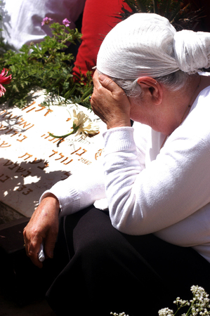 middle east fighting: Relatives of fallen soldiers are at a ceremony to mark Memorial Day or Yom Hazikaron at the Memorial Service for Victims of Terror on Mount Herzl in Jerusalem Monday, April 23, 2007 attended by Israels Prime Minister Ehud Olmert. Yom Hazikaron is a holid