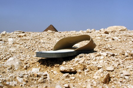khufu: An old jandal that has been left behind as garbage at the great pyramids in Giza, Egypt.