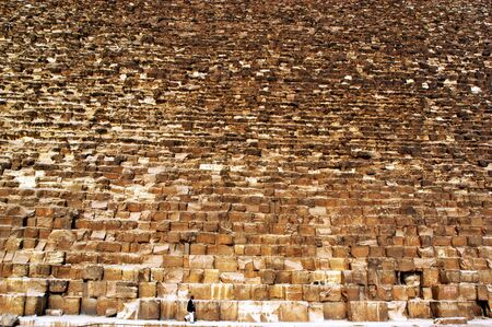 khufu: An Egyptian man walks underneath the Pyramid of Khafre at the great pyramids in Giza, Egypt. Stock Photo