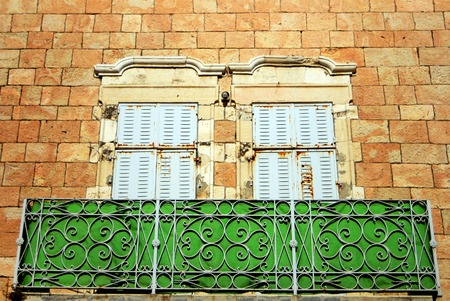 Old balcony on the facade of old building made of Jerusalem Stone in Jerusalem Israel. photo
