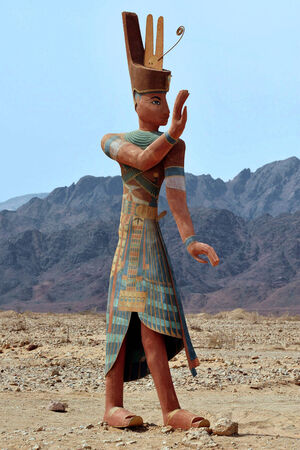 timna: Figure of ancient Egyptian Pharaoh at the entrance to Timna National park, Israel.