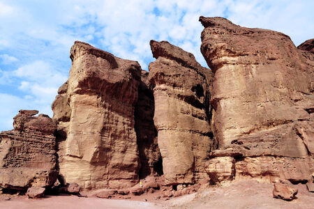 TIMNA, ISR - OCT 15:Visitor at Solomons pillars on October 15 2008.The red Sandstone cliffs in Timna Valley called after King Solomons Pillars at the first Jewish Temple in Jerusalem,Israel.
