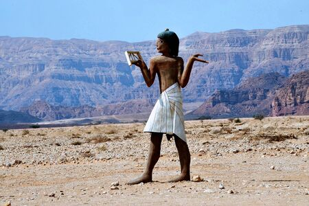 arava: Figure of ancient Egyptian man at the entrance to Timna National park, Israel.