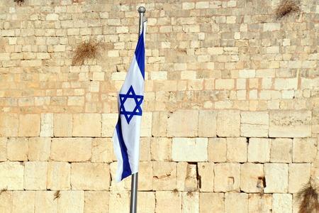 kotel: The Israeli National Flag against the Kotel Wailing Western Wall empty at night in Jerusalem, Israel.