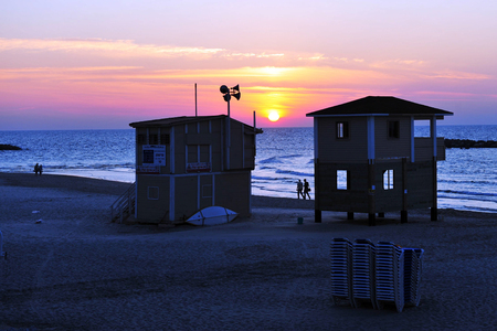 bird of israel: Lifeguard towers along Tel-Aviv beach on the coastline of the Mediterranean sea. Israel. Stock Photo