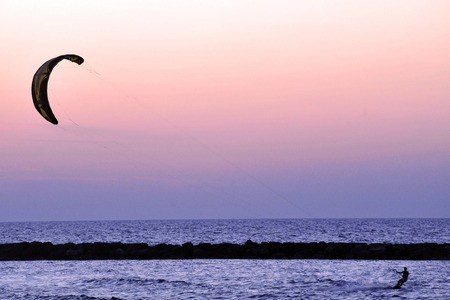 coastline: Kiteboarding along TelAviv beach on the coastline of the Mediterranean sea. Israel.