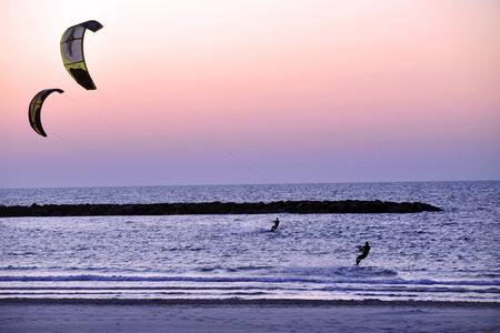 Kiteboarding along Tel-Aviv beach on the coastline of the Mediterranean sea. Israel. photo