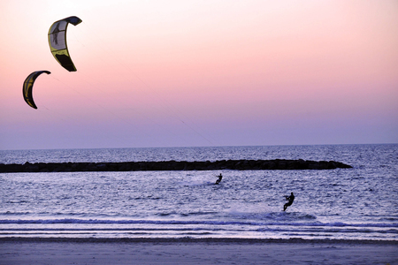 coastline: Kiteboarding along Tel-Aviv beach on the coastline of the Mediterranean sea. Israel.