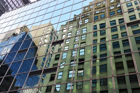 manhattan mirror new york: Reflection of tall  buildings on a skyscraper in Manhattan New York, USA. Stock Photo
